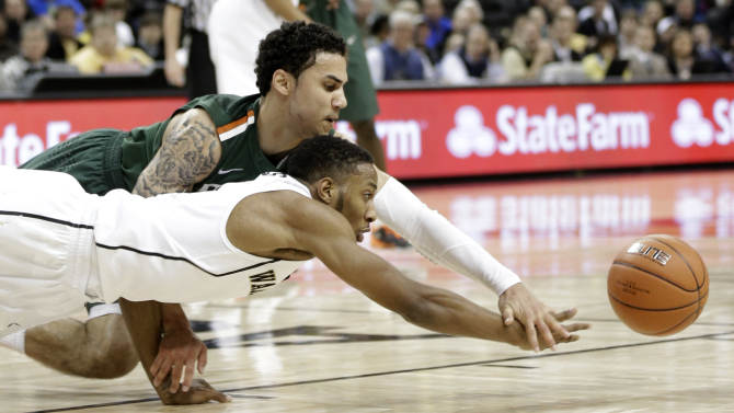 Wake Forest's Madison Jones, front, and Miami's Trey McKinney Jones, back, chase a loose ball during the second half of an NCAA college basketball game in Winston-Salem, N.C., Saturday, Feb. 23, 2013. Wake Forest won 80-65. (AP Photo/Chuck Burton)