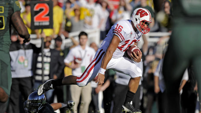 Wisconsin's Russell Wilson runs into the end zone on a 4-yard touchdown against Oregon during the first half of the Rose Bowl NCAA college football game, Monday, Jan. 2, 2012, in Pasadena, Calif. At left is Oregon defensive back Troy Hill. (AP Photo/Mark J. Terrill)
