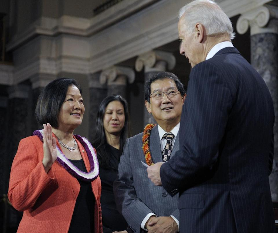 Vice President Joe Biden administers the Senate Oath to Sen. Mazie Keiko Hinoro, D-Hawaii, accompanied by her husband Leighton Kim Oshima, during a mock swearing in ceremony on Capitol Hill in Washington, Thursday, Jan. 3, 2013, as the 113th Congress officially began.  (AP Photo/Cliff Owen)