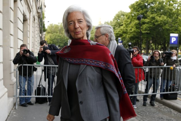 IMF Chief Christine Lagarde and her lawyer Yves Repiquet arrive on the second day of her hearing by French magistrates in Paris