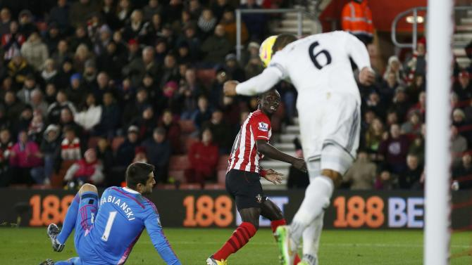 Swansea City's Williams heads the ball clear after an attempt from Southampton's Mane during their English Premier League soccer match in Southampton