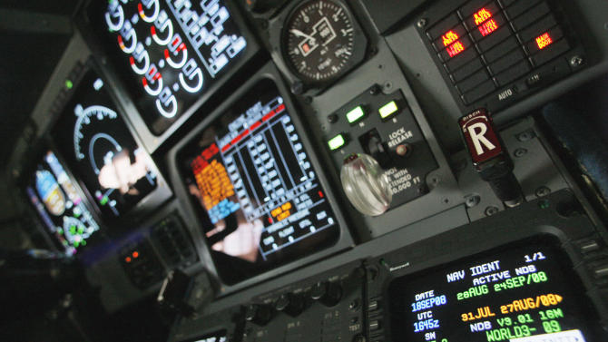 FILE - In this Sept. 18, 2008 file photo, navigation controls are seen in the cockpit of a FAA Gulfstream jet at a hangar at Washington's Reagan National Airport. Industry officials say the federal program to create a new air traffic control system is at a crossroads, making delays possible. (AP Photo/Charles Dharapak, File)