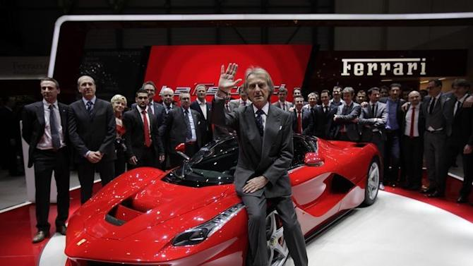 Ferrari CEO di Montezemolo waves to the media after the presentation of the new LaFerrari hybrid car on the Ferrari stand during the 83rd Geneva Car Show in Geneva