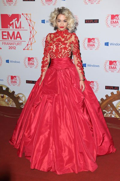 Rita Ora: Somewhere out there, Scarlett O'Hara is missing some curtains. Singer Rita Ora makes sure all eyes are on her in a voluminous fire red lace gown. The detailed lace bits against the sheer