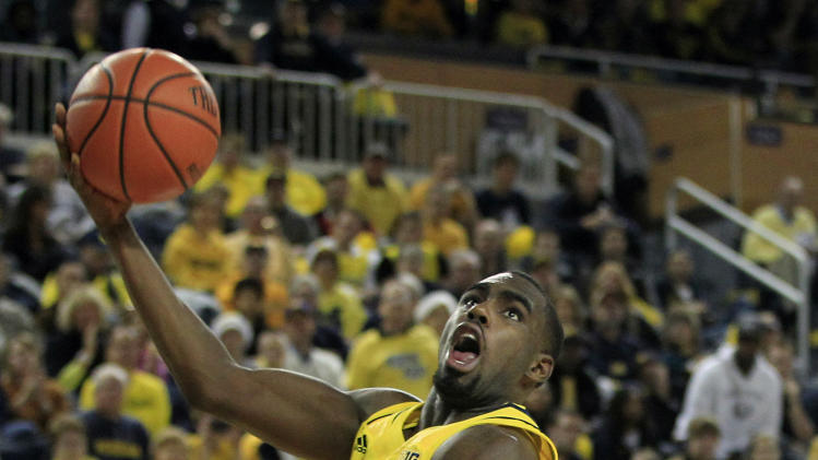 Michigan guard Tim Hardaway Jr. (10) shoots over Arkansas guard Kikko Haydar (20) during the second half of an NCAA college basketball game in Ann Arbor, Mich., Saturday, Dec. 8, 2012. (AP Photo/Carlos Osorio)