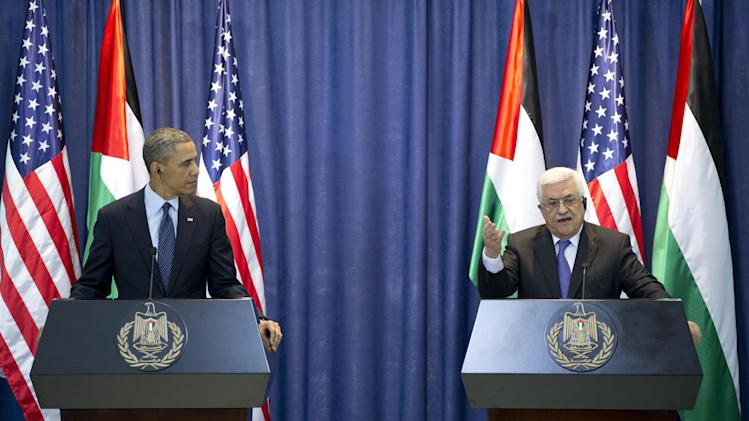 U.S. President Barack Obama, left, and Palestinian President Mahmoud Abbas participate in a joint news conference at the Muqata Presidential Compound, in the West Bank town of Ramallah, Thursday, March 21, 2013. (AP Photo/Carolyn Kaster)