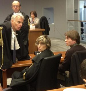 In this picture taken with a mobile phone, US student Amanda Knox's Italian ex-boyfriend Raffaele Sollecito, right, sits with his lawyer Giulia Bongiorno, center, as Amanda Knox's lawyer Carlo Dalla Vedova speaks to them ahead of a hearing in Sollecito and Knox's trial at an appeals court in Florence, Italy, Wednesday, Nov. 6, 2013. Sollecito has arrived at a Florence appeals court to make a statement in the pair's third murder trial over the death of her British roommate Meredith Kercher. Knox and Sollecito's 2009 conviction of murdering Kercher was overturned on appeal in 2011, freeing her to return to the United States. But Italy's highest court ordered a fresh appeals trial, blasting the acquittal as full of contradictions. Knox has not returned to Italy for the latest trial. (AP Photo/Patricia Thomas)