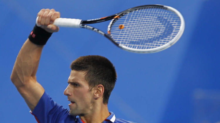 CORRECTS SCORE - Serbia's Novak Djokovic hits a forehand shot to Spain's Fernando Verdasco in the men's final match at the Hopman Cup tennis tournament in Perth, Australia, Saturday, Jan. 5, 2013. Djokovic won the match 6-3, 7-5. (AP Photo/Theron Kirkman)