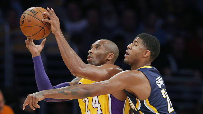 Los Angeles Lakers' Kobe Bryant (24) is defended by Indiana Pacers' Paul George in the first half of an NBA basketball game in Los Angeles, Tuesday, Nov. 27, 2012. (AP Photo/Jae C. Hong)