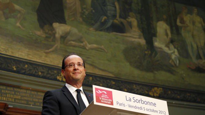 France's President Francois Hollande, pauses as he delivers a speech to the assembly of the Territorial Democracy Forum at Sorbonne University in Paris Friday Oct. 5, 2012.  (AP Photo/Gonzalo Fuentes, Pool)