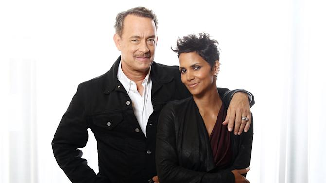 """In this Oct. 14, 2012 photo, actors Tom Hanks, left, and Halle Berry, from the upcoming film """"Cloud Atlas,"""" pose for a portrait in Beverly Hills, Calif. The stars of """"Cloud Atlas,"""" along with British author David Mitchell, who wrote the novel that inspired the genre-bending epic about souls returning and intertwining over the centuries, shared their beliefs and disbeliefs about reincarnation as the film heads to U.S. theaters Oct. 26, 2012. Hanks himself doesn't buy into reincarnation, while Berry, Whishaw, Mitchell, Sarandon and co-stars Hugo Weaving and Jim Sturgess either believe or at least think it's possible that souls come back for an encore. (Photo by Matt Sayles/Invision/AP))"""