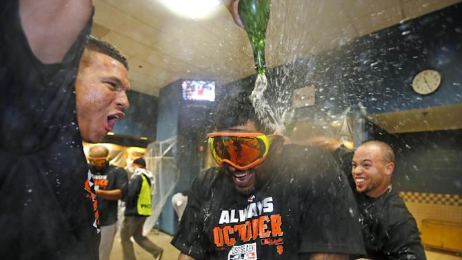 San Francisco Giants' Pablo Sandoval, center, is doused by teammates as they celebrate the Giants' 8-0 win over the Pittsburgh Pirates in the National League wild-card baseball playoff game in Pittsburgh on Wednesday, Oct. 1, 2014. (AP Photo/Gene J. Puskar)
