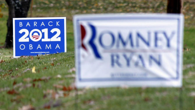 Campaign signs for both President Barack Obama, and his challenger, Republican presidential candidate, former Massachusetts Gov. Mitt Romney are seen in yards outside Evans City, Pa., Friday, Nov. 2, 2012. In the final days of the presidential campaign, Romney is making a concerted push into Pennsylvania, aided by outside political groups that are spending millions in last minute ads in the state to help erode Obama's 2008 support. Polling shows Obama holding on to a 4 or 5 percentage point lead over Romney, but the trend has been in Romney's favor. (AP Photo/Keith Srakocic)