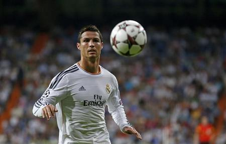 Real Madrid's Cristiano Ronaldo controls a ball during the soccer match against FC Copenhagen