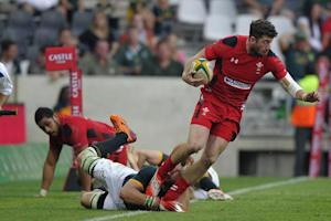 Wales wing Alex Cuthbert (R) is tackled during the…