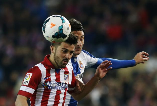Atletico Madrid's Villa fights for the ball with Espanyol's Colotto during their Spanish first division soccer match at Vicente Calderon stadium in Madrid,