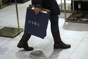A woman holds a bag inside a Zara store in central Madrid