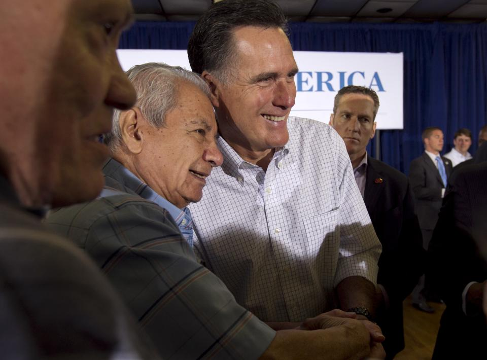 Republican presidential candidate, former Massachusetts Gov. Mitt Romney, center right, greets people during a campaign stop Sunday, March 18, 2012, in Moline, Ill. (AP Photo/Steven Senne)