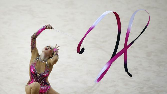 South Korea's Gim Yun-hee performs with the ribbons in the individual rhythmic gymnastics competition at the Namdong Gymnasium Club during the 17th Asian Games in Incheon