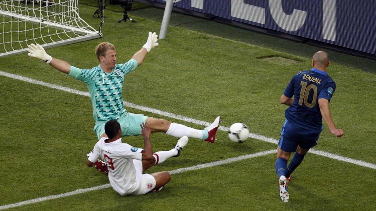 France's Karim Benzema, right, makes an unsuccessful attempt at goal past England goalkeeper Joe Hart during the Euro 2012 soccer championship Group D match between France and England in Donetsk, Ukraine, Monday, June 11, 2012. (AP Photo/Vadim Ghirda)