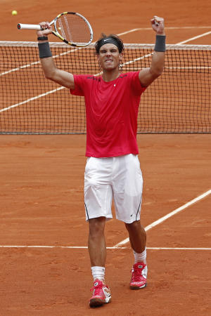 Rafael Nadal of Spain celebrates winning his quarter final match against compatriot Nicolas Almagro at the French Open tennis tournament in Roland Garros stadium in Paris, Wednesday June 6, 2012. Nadal won in three sets 7-6, 6-2, 6-3. (AP Photo/Bernat Armangue)