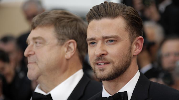 Actors John Goodman, left, and Justin Timberlake arrive for the screening of the film Inside Llewyn Davis at the 66th international film festival, in Cannes, southern France, Sunday, May 19, 2013. (AP Photo/Lionel Cironneau)