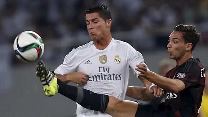 Ronaldo of Real Madrid fights for the ball with Mattia of A.C. Milan during the International Champions Cup soccer match in Shanghai