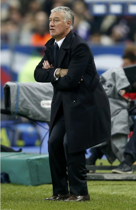 France's coach Didier Deschamps reacts during the 2014 World Cup qualifying match against Georgia at the Stade de France stadium in Saint-Denis