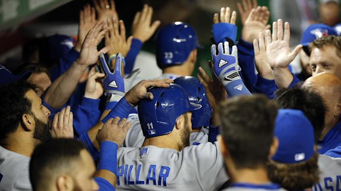 Toronto Blue Jays' Kevin Pillar (11) celebrates his three-run home run during the sixth inning of the second baseball game of a doubleheader against the Washington Nationals at Nationals Park, Tuesday, June 2, 2015, in Washington. (AP Photo/Alex Brandon)