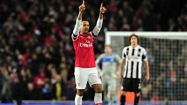 Arsenal's English striker Theo Walcott celebrates scoring the opening goal of the English Premier League football match between Arsenal and Newcastle United at The Emirates Stadium in north London, England on December 29, 2012 (AFP)