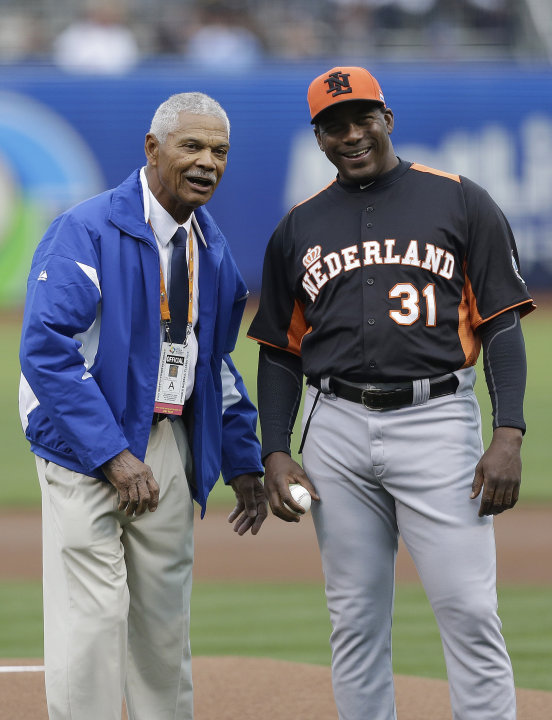 Former baseball player Felipe Alou, left, and the Netherlands' manager Hensley Meulens prepare to throw out the ceremonial first pitch before a semifinal game of the World Baseball Classic between the