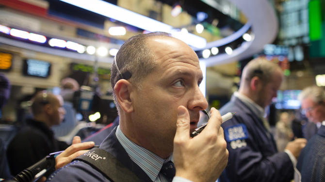 Trader Michael Urkonis works on the floor of the New York Stock Exchange, Friday, Oct. 26, 2012, in New York. (AP Photo/John Minchillo)