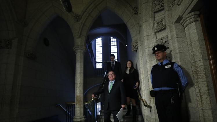 Canada's Finance Minister Flaherty walks to the House of Commons on Parliament Hill in Ottawa