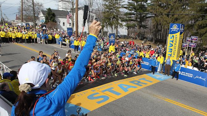 Jacqueline Benson shoots the starting piston for the elite womens start of the 117th running of the Boston Marathon, in Hopkinton, Mass., Monday, April 15, 2013. (AP Photo/Stew Milne)