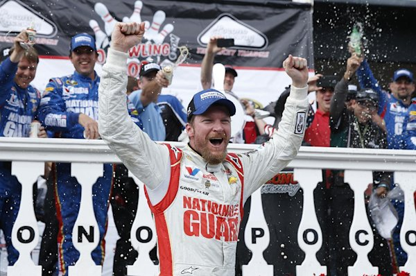 In this Aug. 3, 2014 file photo, Dale Earnhardt Jr. celebrates in