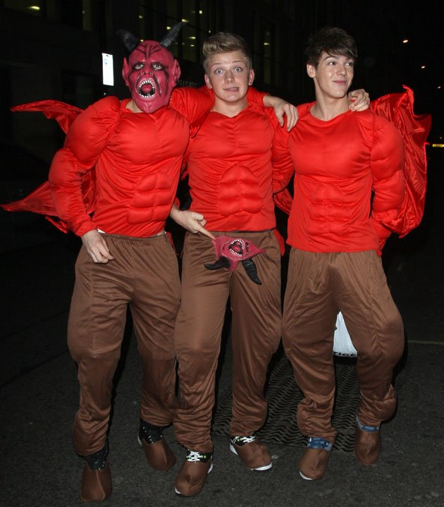 X Factor boyband District3 don't scare us much in their devil costumes. Copyright [Wenn]