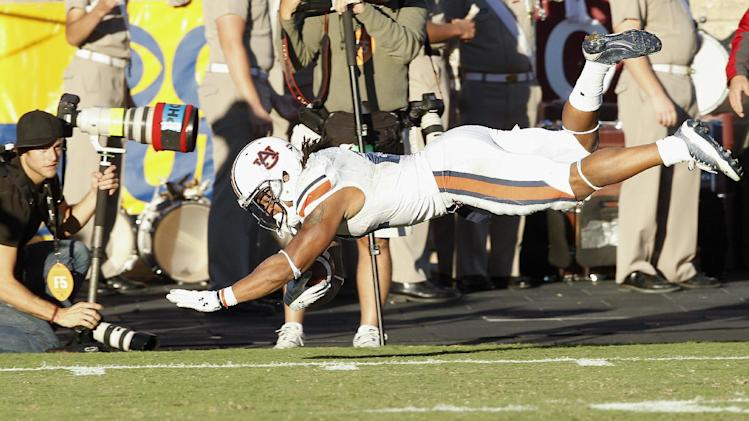 Auburn running back tre mason 21 dives for extra yardage after
