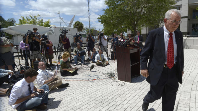 Florida State Attorney Lawson Lamar, right, leaves a news conference after announcing charges against 13 people in the hazing death of Florida A&M University drum major Robert Champion during a news conference in Orlando, Fla., Wednesday, May 2, 2012. The charges were announced more than five months after Champion, 26, died aboard a chartered bus parked outside an Orlando hotel following a performance against a rival school.  (AP Photo/Phelan M. Ebenhack)