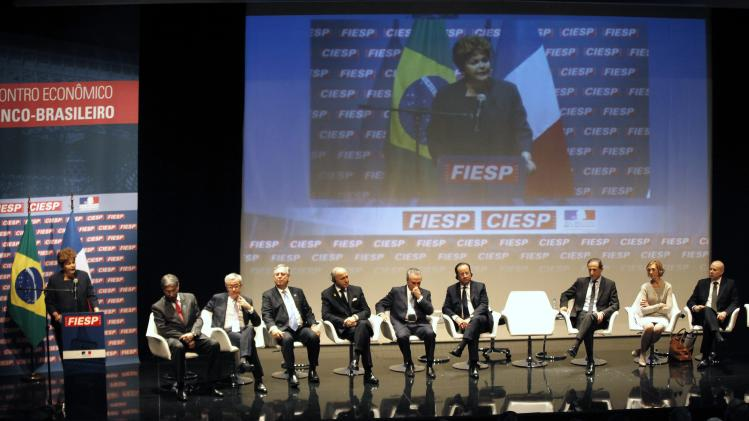 Rousseff gives a speech as Hollande looks on during a meeting with businessman at FIESP in Sao Paulo