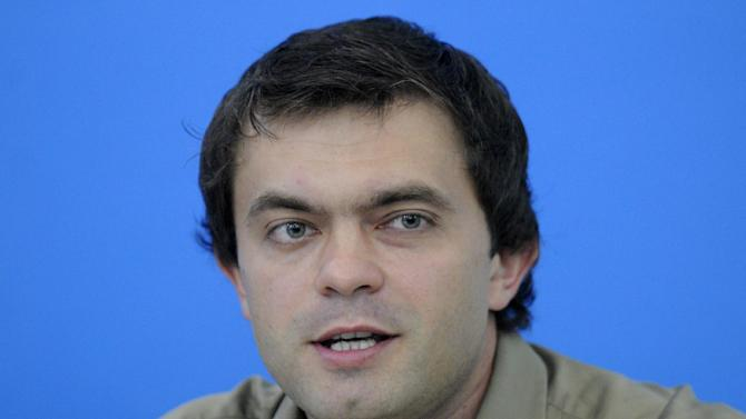 """Ruslan Kukharchuk, a journalist who heads the movement """"Love against homosexuality"""" talks to reporters in Kiev, Ukraine, Monday, July 23, 2012. Kukharchuk supports a bill that would ban the """"propaganda of homosexuality"""" . (AP Photo/Sergei Chuzavkov)"""