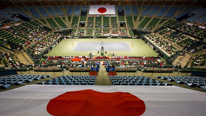 Japanese national flags are draped across seats in Ariake Coliseum as Olga Govortsova of Belarus plays Kurumi Nara of Japan during their FedCup World Group II play-off tennis match in Tokyo