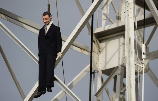 An effigy of Spain's Prime Minister Mariano Rajoy is seen hanging at the entrance of the Pozo Santiago mine in Caborana