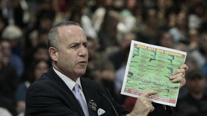 State Senate President Pro Tem Darrell Steinberg, D-Sacramento, displays a newspaper ad showing the type of assault style rifle that his proposed legislation would ban in California during a hearing of the Senate Public Safety Committee in Sacramento, Calif., Tuesday, April 16, 2013.  Steinberg's  measure, SB374, which would outlaw rifles with detachable magazines, is one of seven bills that Senate Democrats have proposed to tighten California's already strict gun control laws.(AP Photo/Rich Pedroncelli)