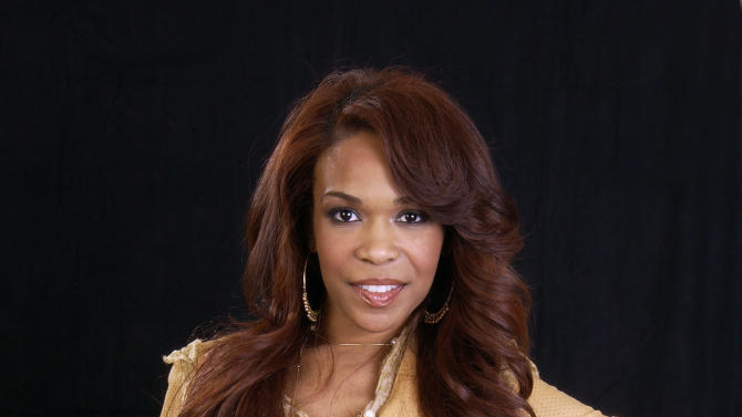 FILE - This Nov. 16, 2004 file photo shows singer Michelle Williams posing for a photo at the Rhigha Royal Hotel in New York. The singer-actress _ one third of Destiny's Child alongside Beyonce and Kelly Rowland _ said that in the past few months she has emerged from years of suffering from moderate depression. Her dark cloud lifted thanks to exercise, therapy and positive thinking. (AP Photo/Jim Cooper, file)