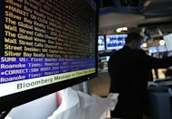 A Bloomberg terminal displays news as a trader works on the floor of the New York Stock Exchange May 13, 2013. REUTERS/Brendan McDermid/Files