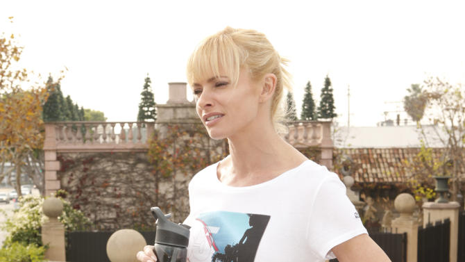 Jaime Pressly after working out wearing a 35MM Clothing T-Shirt, Aviator Nation pants and a Contigo water bottle on Tuesday December 4, 2012 in Los Angeles, California. (Photo by Todd Williamson/Invision/AP Images)