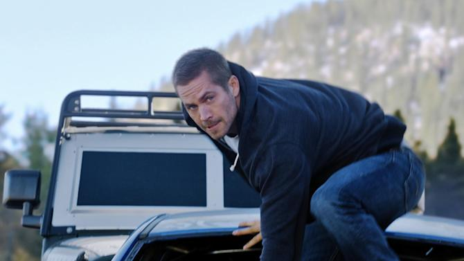"FILE - This undated file photo provided by Universal Pictures shows, Paul Walker as Brian, in a scene from ""Furious 7.""  ""Furious 7"" topped ""Age of Adaline"" and lead the box office for a fourth straight week. The Universal action film made an estimated $18.3 million in North American theaters over the weekend, according to studio estimates Sunday, April 26, 2015. (AP Photo/Universal Pictures, File)"