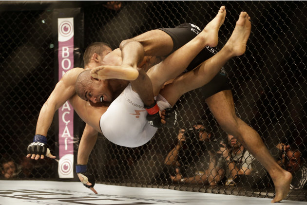 Sergio Moraes fights countryman Renee Forte during their welterweight match at UFC 153. (AP)