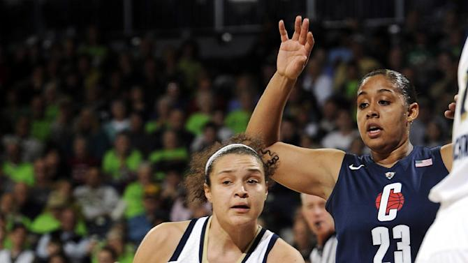 Notre Dame guard Kayla McBride, left, throws a pass around Connecticut guard Kaleena Mosqueda-Lewis during the first half of an NCAA college basketball game, Monday, March 4, 2013, in South Bend, Ind. (AP Photo/Joe Raymond)