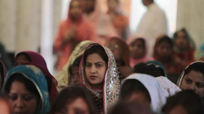 Pakistani Christian women attend early Easter Mass at St. Anthony Church in Lahore, Pakistan on Sunday, March 31, 2013. (AP Photo/K.M. Chaudary)